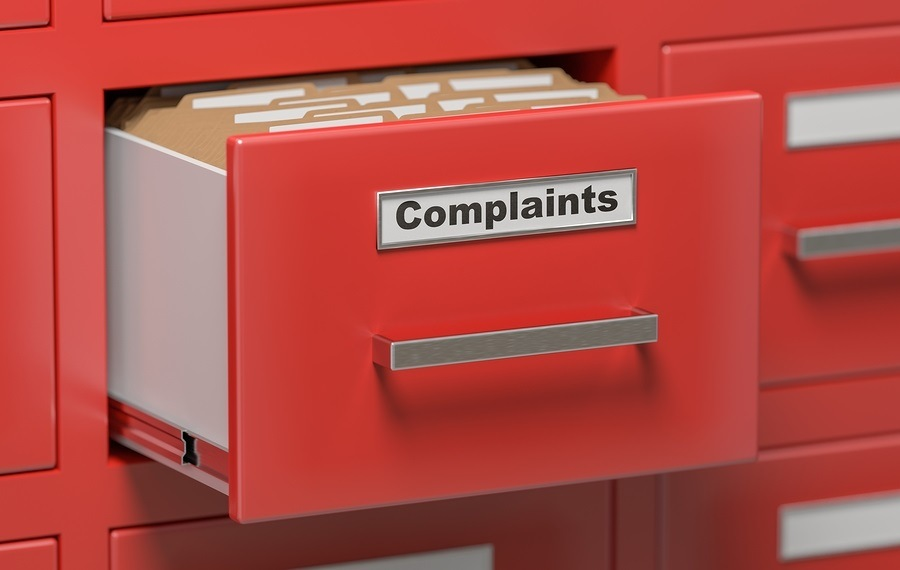 Complaints files and documents in cabinet in office. 3D rendered illustration.