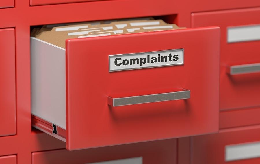 Complaints filed in filing cabinet. 3D rendered illustration.