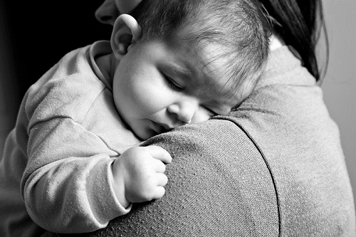 Little Baby girl sleeping in mothers arms - Lifestyle black and