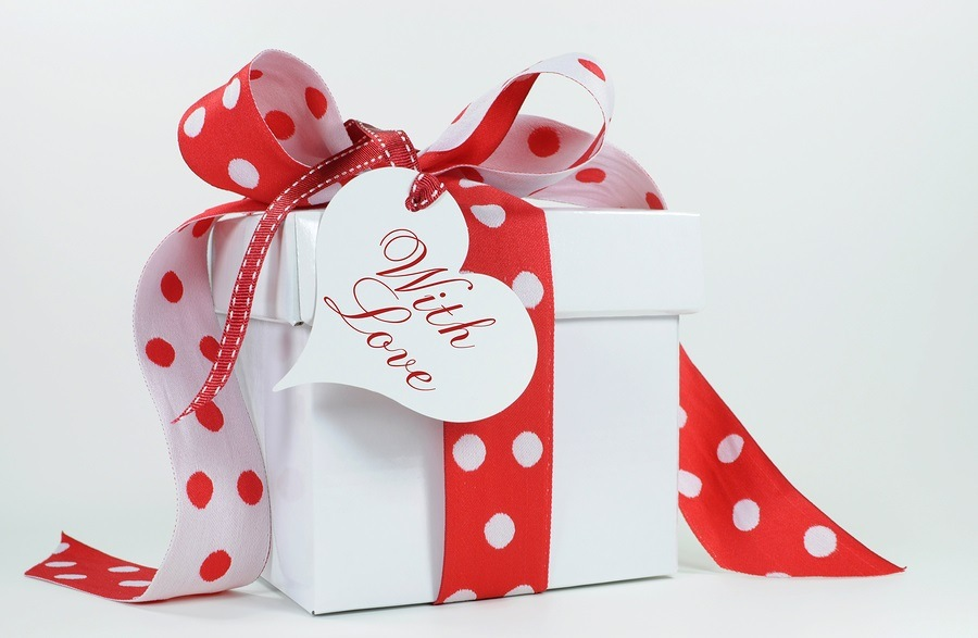 Red and white polka dot theme gift box present with heart shape gift tag with love image.