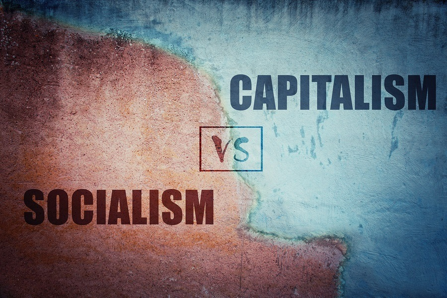 Socialism versus capitalism split concrete wall cracked in two different halves, red and blue side. Socialist centralized economic planning vs capitalist liberated free market. Future strategy choice.
